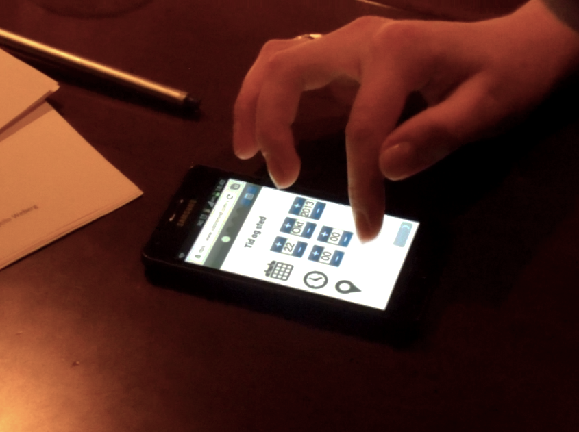 Picture from the user testing of our app with a phone